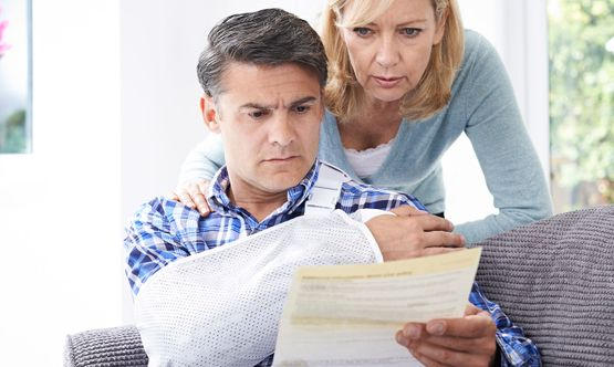 A injured man and his wife reading a letter
